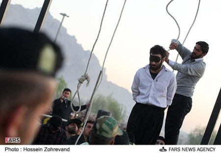 A man is prepared for public execution in Iran