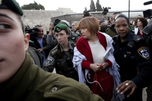 Woman arrested at the Western Wall for praying in public with a prayer shawl, April 11, 2013.