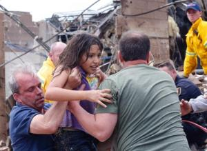 Child being pulled to safety, Moore Oklahoma (Sue Ogrocki/AP)