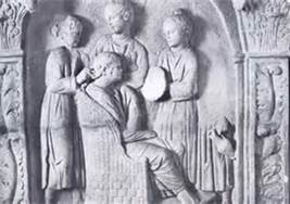 Roman slaves styling the hair of their mistress (carving)