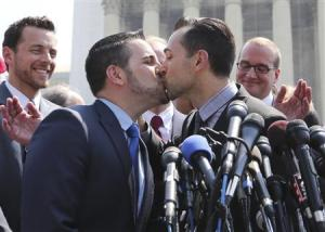 Paul Katami (R) shares a kiss after proposing marriage to Jeff Zarrillo (L) as the two plaintiffs in the case against California's gay marriage ban known as Prop 8 (Reuters)