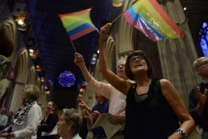 Parishioners at the Washington National Cathedral celebrate in a prayer service after the June 26 Supreme Court Ruling