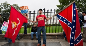 Confederate flag-waving protester at a Tea Party-sponsored Veterans rally, October 13, 2013