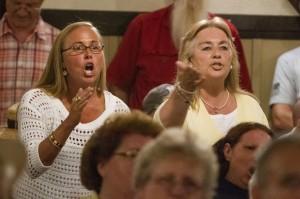 Women arguing with Mayor Miner at Syracuse hearing.  Michael Okoniewski/Washington Post.